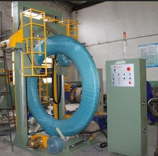 Large hose coil stretch wrapping