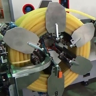 Pipe coiling and strapping machine