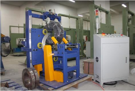Pipe and hose coil stretch wrapping machines