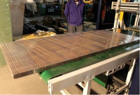 stretch wrapping wooden door by machine