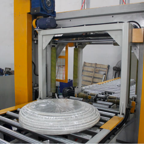Reel wrapping machine for packaging steel coils, bearing and reels